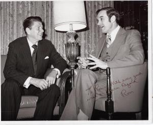 Ron Paul having a cheery old time with Ronald Reagan. Image is a picture signed to Paul by Reagan.